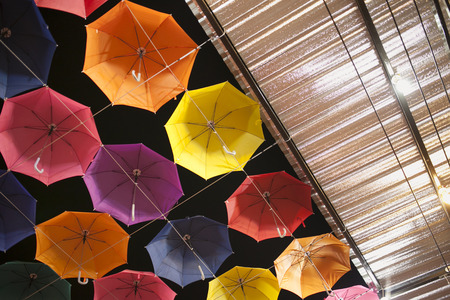 night market: Lots of umbrellas coloring the sky in Night Market Stock Photo