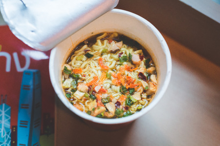 Close up Noodle cup with a Plastic Fork. Stock Photo