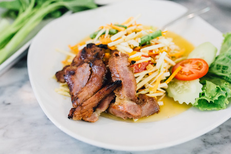 Papaya Salad with Grilled Pork Neck