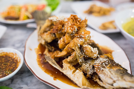 Deep Fried Sea Bass with Sauce on white dish,Thai food.