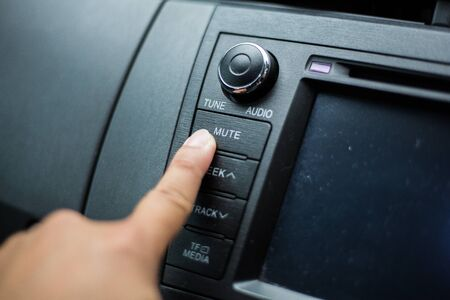 Photo of multimedia control buttons in the car.