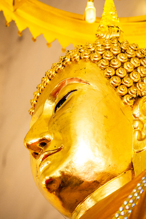 Close up face of Buddha in temple thailand.