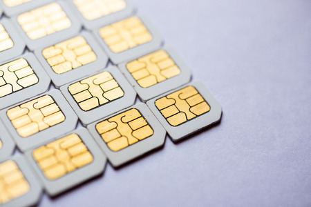 Many Micro SIM 3G for mobile over on white background. Stock fotó