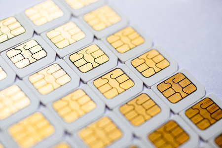 Many Micro SIM 3G for mobile over on white background. Foto de archivo