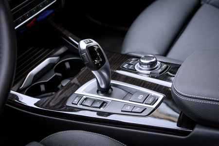 WROCLAW, POLAND - OCTOBER 31, 2017: close-up photo of gear selector of automatic gearbox of the BMW X3 xDrive