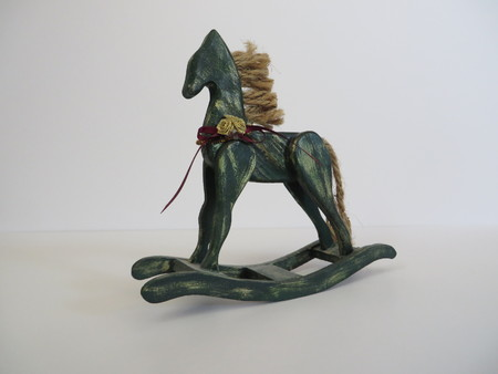 Green and gold wooden rocking horse decoration