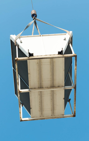 ventilate: Air compressor on roof of factory with blue sky background.
