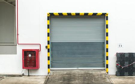 Building made of concrete with roller shutter door Foto de archivo