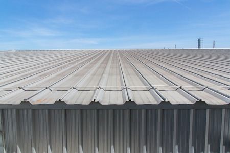 rivet metal: Architectural detail of metal roofing on commercial construction