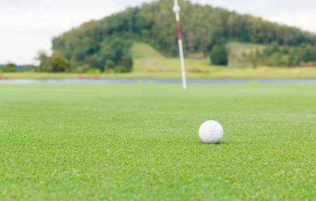 caddie: golf ball on lip of cup Stock Photo