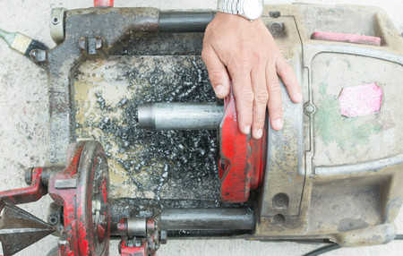 threading: Pipe threading machine Stock Photo