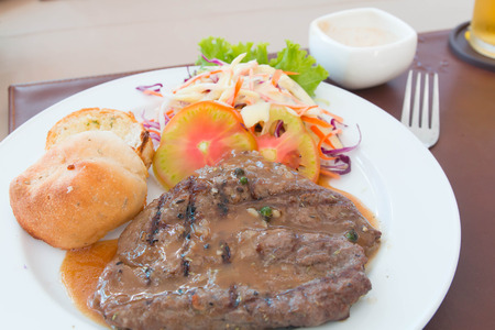 woodenrn: Succulent thick juicy portions of grilled fillet steak served with tomatoes and roast vegetables on an old wooden board