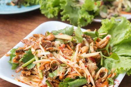 sour food: Herb salad with deep fried fish and shrimp Thai fusion and healthy food