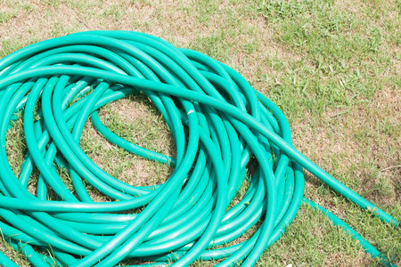plastic conduit: Rubber tube for watering plants in the garden. Stock Photo