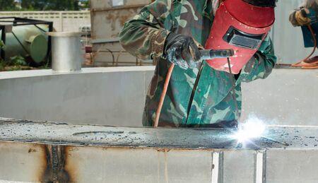 sparking: industrial worker welding sparking Stock Photo