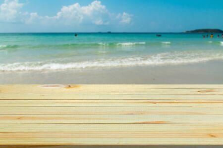 on wood floor: wood floor with blurred sea background.