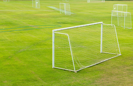 vacant: A view of a net on a vacant soccer pitch.