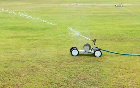 sprinkle system: Watering turf Stock Photo