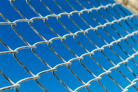 perspective grid: fence with metal grid in perspective Stock Photo