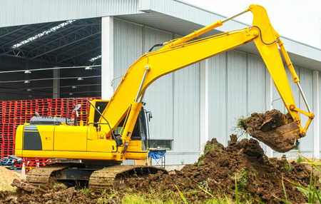 Excavator and grader working at construction site Stock Photo