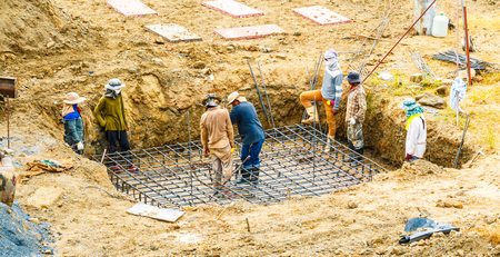 Foundation site of new details and reinforcements with steel bars and wire rod, preparing for cement pouring Editorial