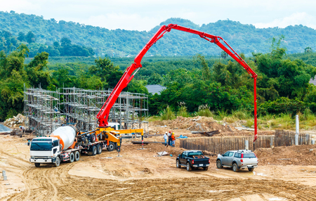construction building works with concrete pump for pouring. Stock Photo