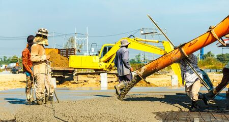 concreting work: construction site worker during concrete