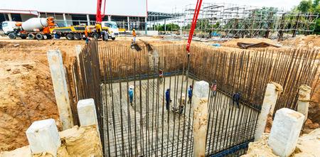 construction building works with concrete pump for pouring. Banco de Imagens - 98918003