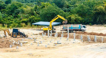 excavator at sandpit during earthmoving works Banco de Imagens - 98918001