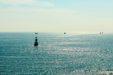White Lighthouse on the sea and blue sky Banco de Imagens