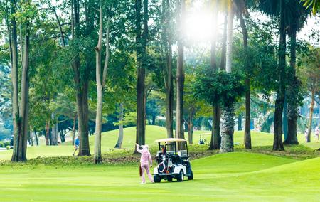 Golf-cart car on grass field of golf course Banco de Imagens - 98918059