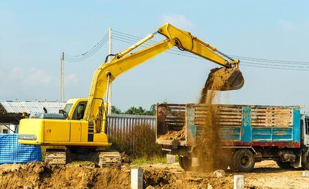 excavator at sandpit during earthmoving works Banco de Imagens - 98918060
