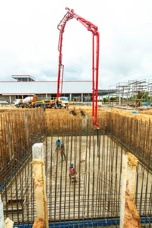 construction building works with concrete pump for pouring. Banco de Imagens - 98918071