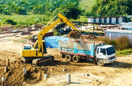 excavator at sandpit during earthmoving works Banco de Imagens - 98918087