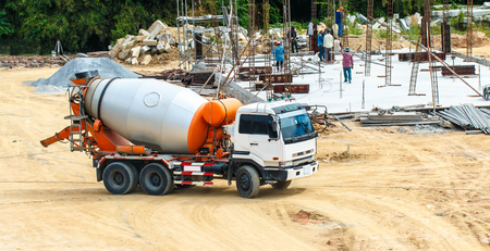 foundation from cement to a new building ground truck mixer hard working Banco de Imagens - 98918089