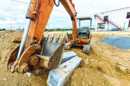excavator at sandpit during earthmoving works Banco de Imagens - 98918095