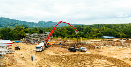 construction building works with concrete pump for pouring. Banco de Imagens