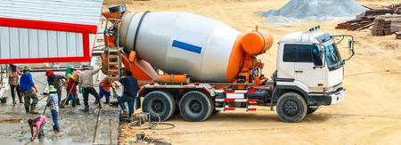 Foundation from cement to a new building ground truck mixer hard working Banque d'images