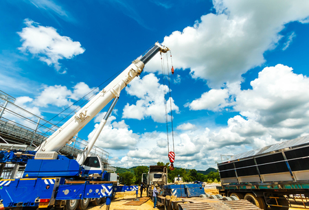 Truck and Crane in site for construction and blue sky Editorial