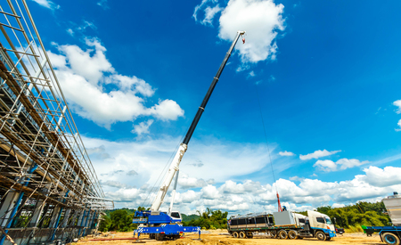 Truck and Crane in site for construction and blue sky Banco de Imagens