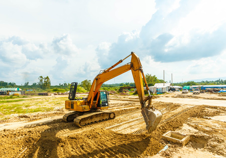 Excavator at sandpit during earth moving works