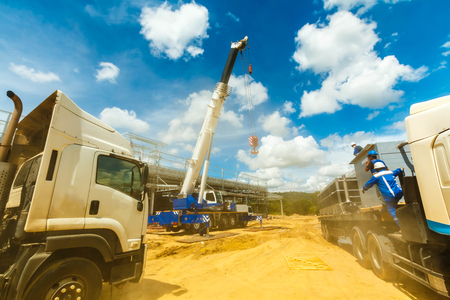 Truck and Crane in site for construction and blue sky Banco de Imagens - 104543768
