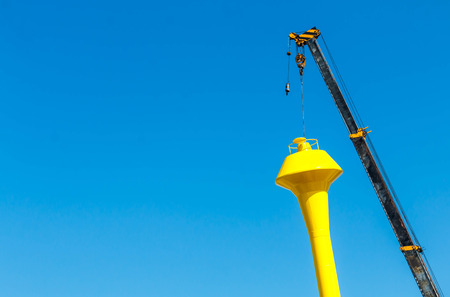 Truck and Crane water tank construction and blue sky Banco de Imagens