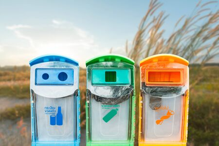 Recycling bins on a blurred background ecology concept.