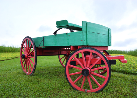 green and red old cart with nice sky Stock Photo