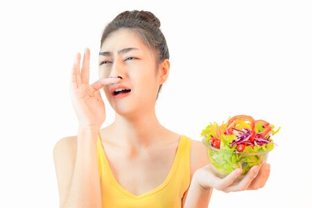 Young beautiful asian woman wore yellow undershirt, Holding a salad glass cup isolated on white background dummbell