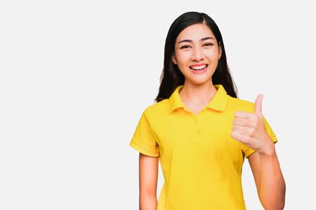 Young smart beautiful asian woman wore yellow t shirt, smiling, confidence, Excellent, admired, done very well, isolated on white background