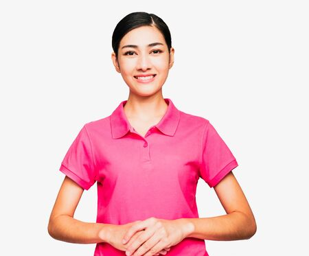 Young smart beautiful asian woman wore pink t shirt,smiling,confidence, Excellent, admired, done very well,gesturing her hand isolated on white background