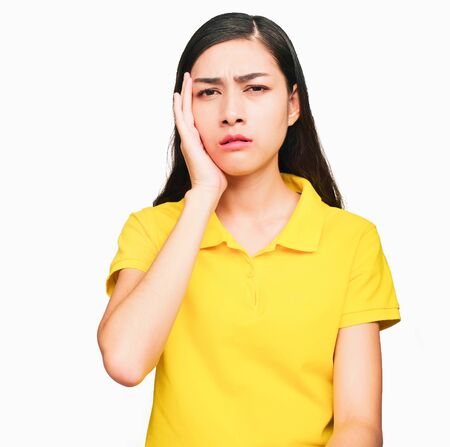 Young smart beautiful asian woman wore yellow t shirt,smiling,confidence, Excellent, admired, done very well, isolated on white background make gesture Variety of emotions