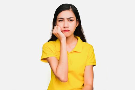 Young smart beautiful asian woman wore yellow t shirt,smiling,confidence, Excellent, admired, done very well, isolated on white background make gesture Variety of emotions Imagens